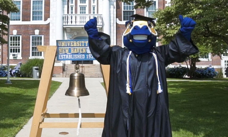Image of Charlie ringing the alumni bell