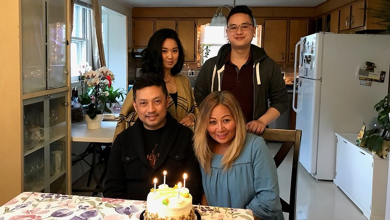 Colby Thammavongsa celebrates his mother and father's birthday this past year.