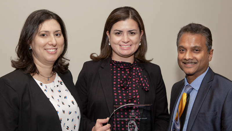 Photo of Prof. Maria-Isabel Carnasciali, Carolina Ramirez-Blier '09, and Dean Ron Harichandran