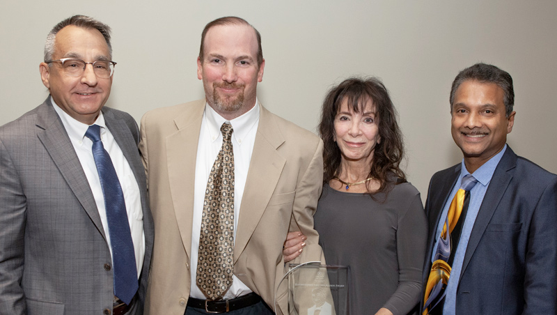 Photo of Provost Dan May, William (Bill) O'Brien's son, Sean, and wife, Jean, and Dean Ron Harichandran
