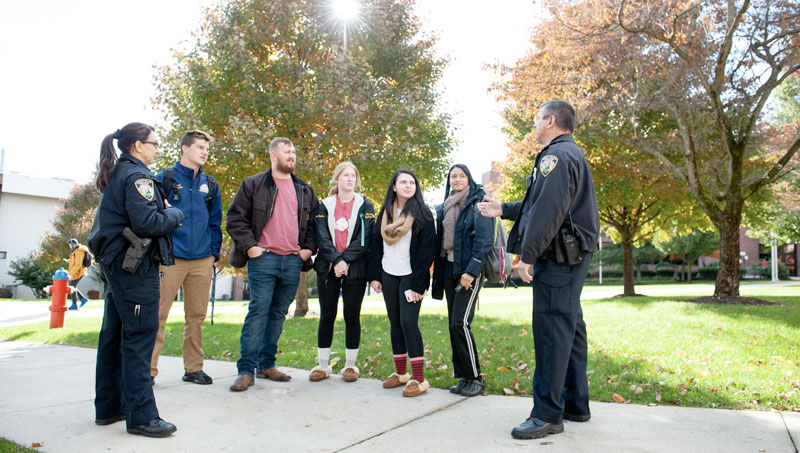 Ony Sierra and James Mroczka meet with students on campus.