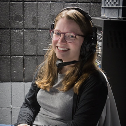 Rebecca Satzberg with headset