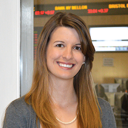 An image of smiling business management alumnus, Lauren Ritchie.